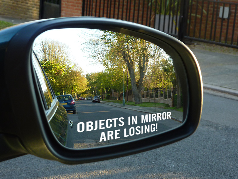 Objects in mirror are losing Vinyl Sticker
